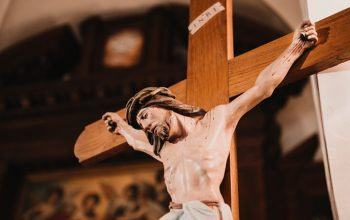 An Image of Jesus Crucifies in the cross.
